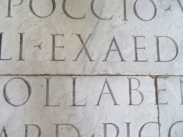 roman script from a church - Italy photo