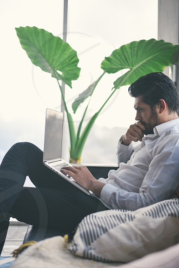 young man working from home photo