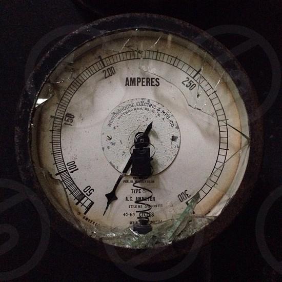 brass white faced round amperes gauge photo