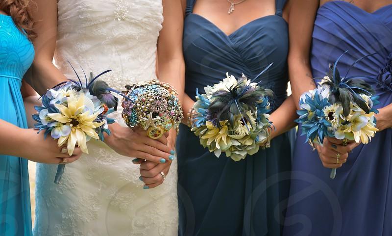 Wedding Bouquets; flowers; blues; dresses  photo