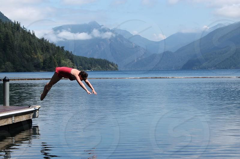 Beautiful Washington backdrop to diving girl photo