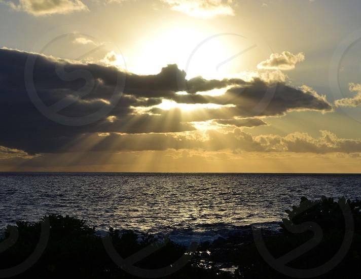 Maui Hawaii - brilliant sunset over the ocean  photo