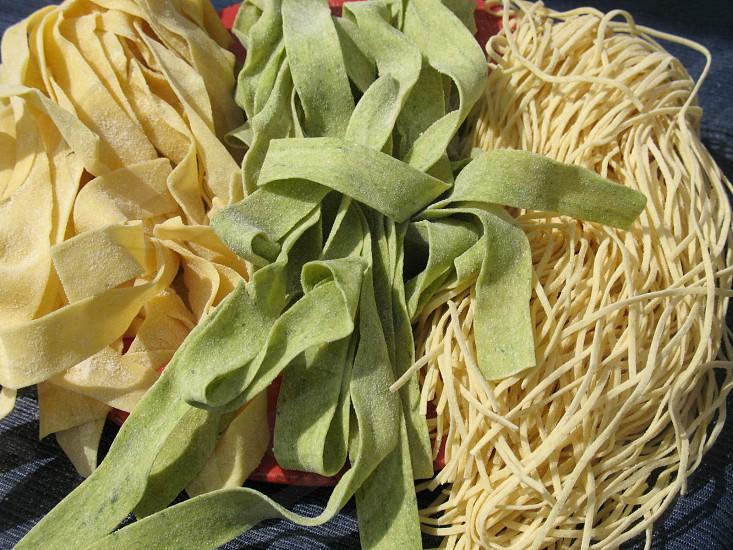 Handmade pastas wide & narrow pesto and egg noddles photo