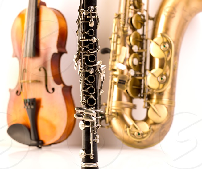 Music Sax tenor saxophone violin and clarinet in white background photo