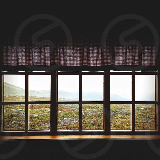 black framed closed window photo