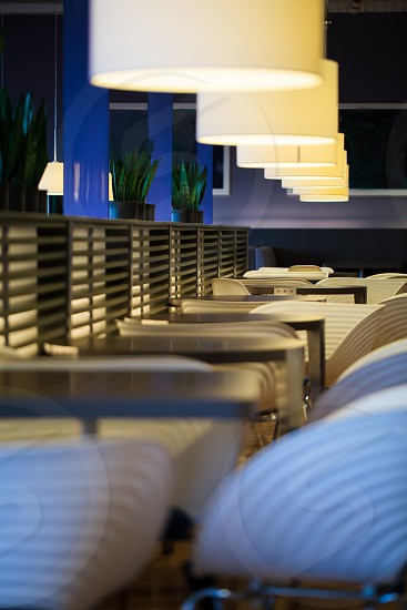 Bar or restaurant with empty tables and chairs in modern design photo