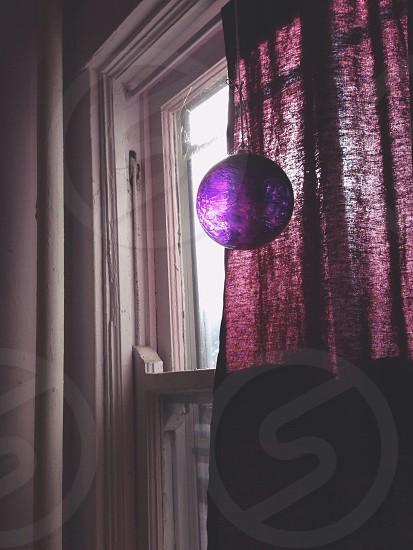 purple glass globe ornament photo
