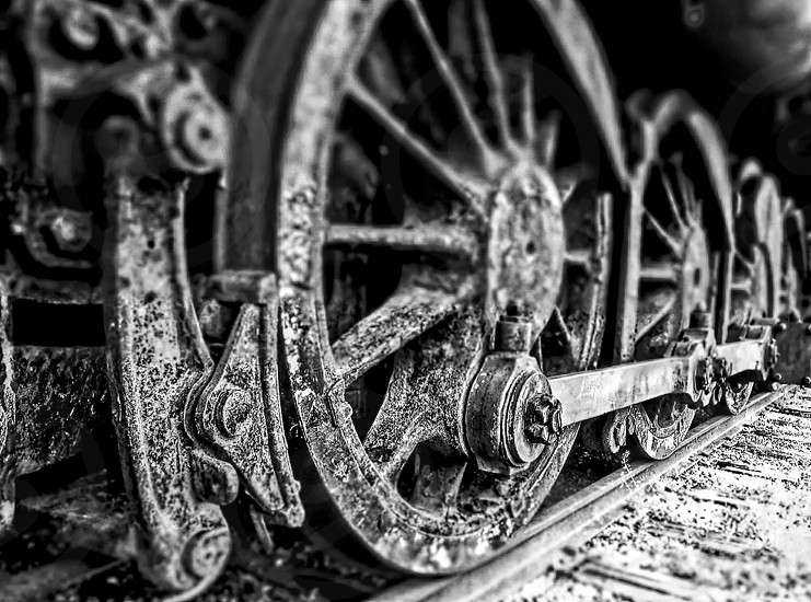 Wheels and brakes of old steam locomotive train wheels photo