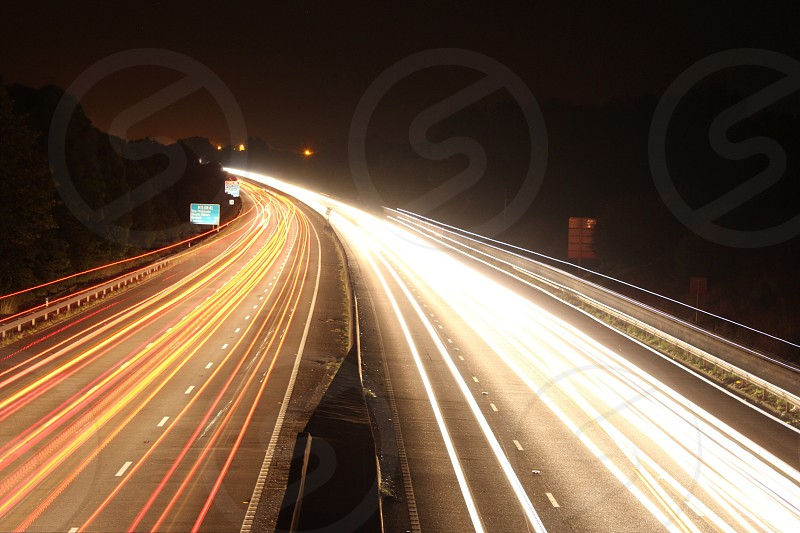 A photo showing the light trails of cars on a motorway at night. Taken near Taunton Somerset  England.   photo