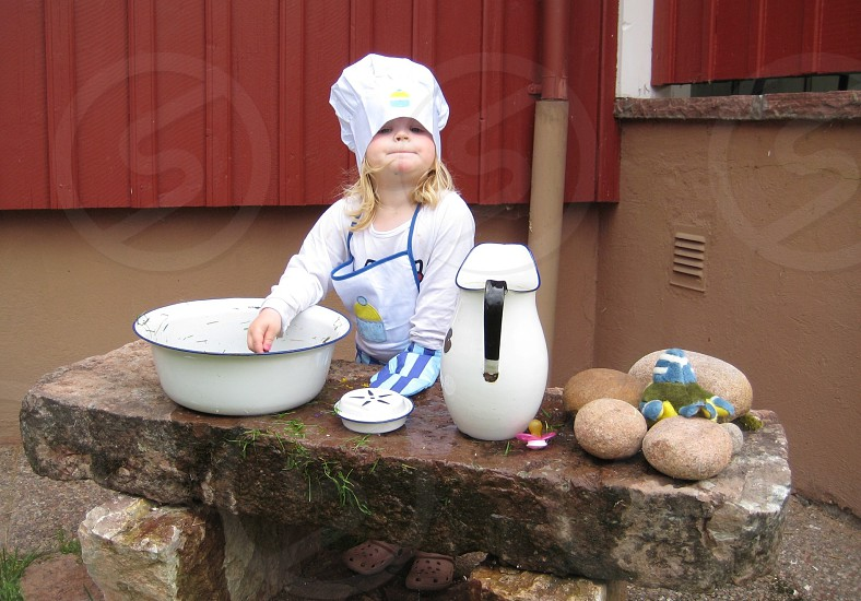 Playing toys can stone baker girl child photo
