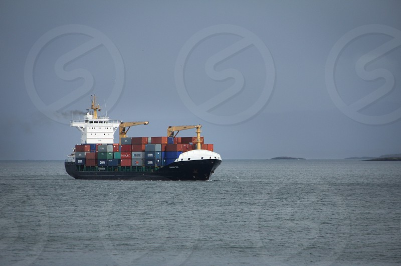 Container ship on the Beagle Channel near Ushuaia Argentina. Tierra del Fuego Patagonia. photo