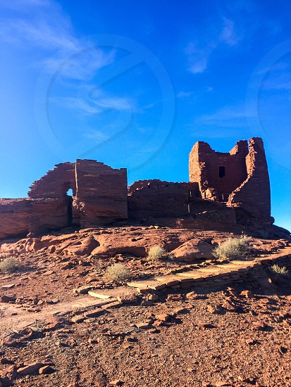 low-angle photography of brown rock structure photo