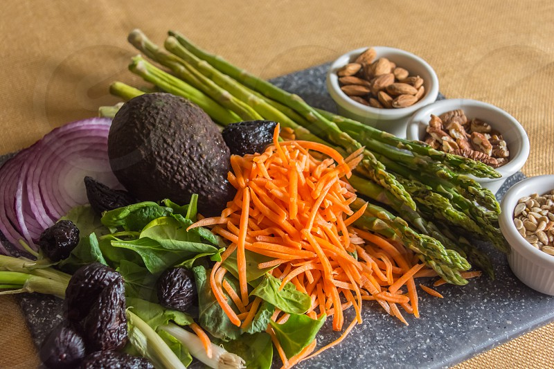 healthy foods onion fig spinach avocado asparagus carrots almonds sunflower seeds pecans  photo