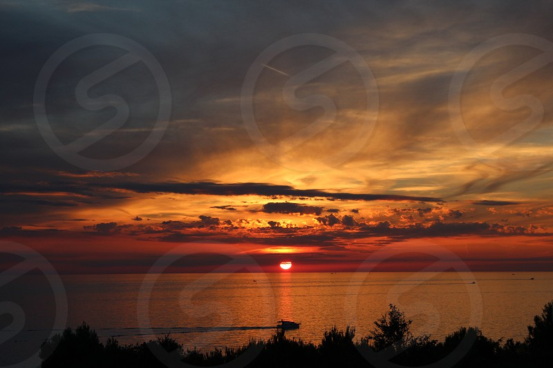 sunsets on the sea photo