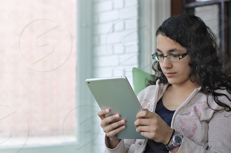 Girl using a tablet at home photo