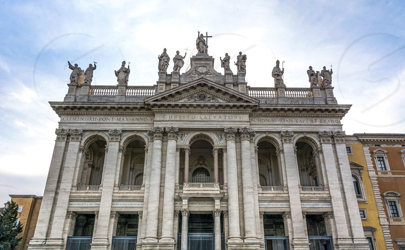 The Papal Archbasilica of St. John in Lateran commonly known as St. John Lateran Archbasilica St. John Lateran Basilica St. John Lateran or simply the Lateran Basilica is the cathedral church of Rome and therefore houses the cathedra or ecclesiastical seat of the Roman Pontiff (Pope). photo