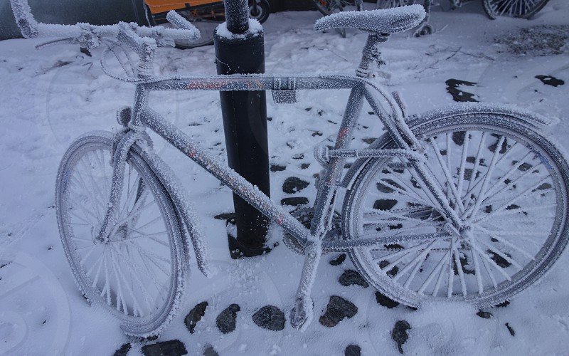 Frozen bicycle on extremely cold winter morning in Helsinki Finland photo