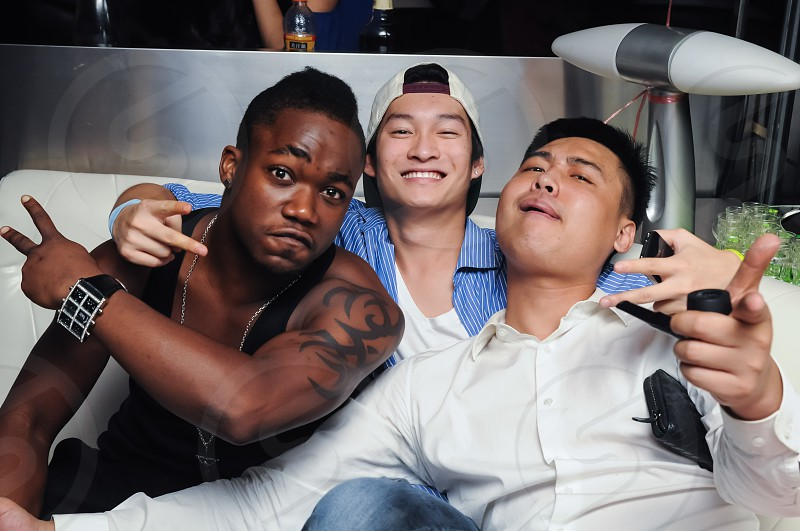 Interracial Club Scene Friends Clubbing Brothers in the Bar photo