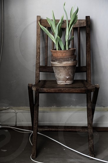 Chair improvement abandoned alone grey gray green brown cable cables wooden clay handmade wall background wallpaper photo