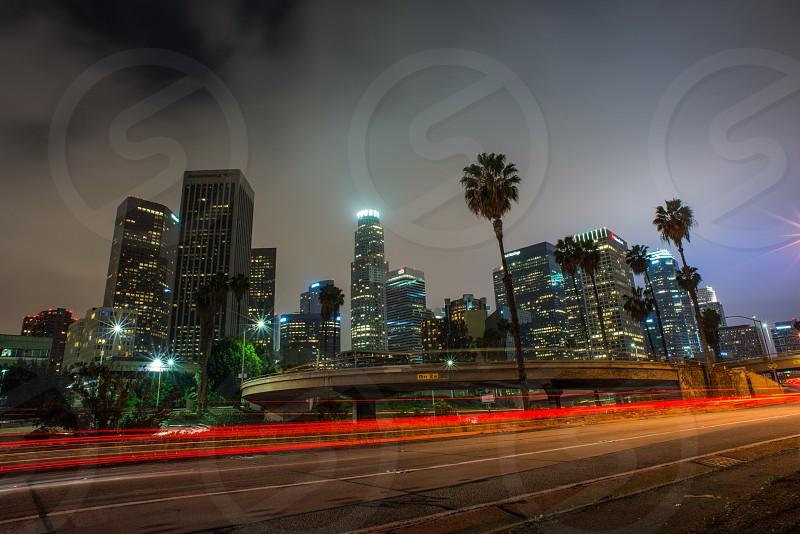 Los Angeles night freeway light trails long exposure skyline city downtown photo