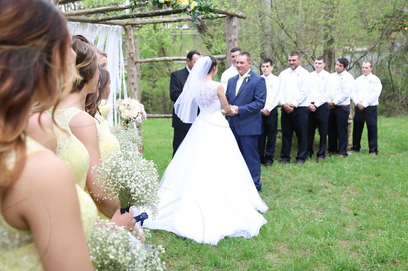 wedded couple with groomsmen and bridesmaids photo