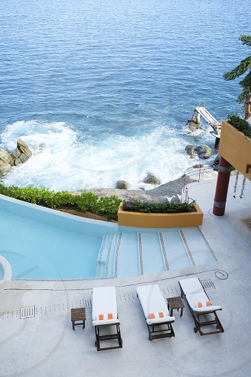 Ocen front property terrace with infinity swimming pool view from above. Puerto Vallarta South Shore Jalisco Mexico photo