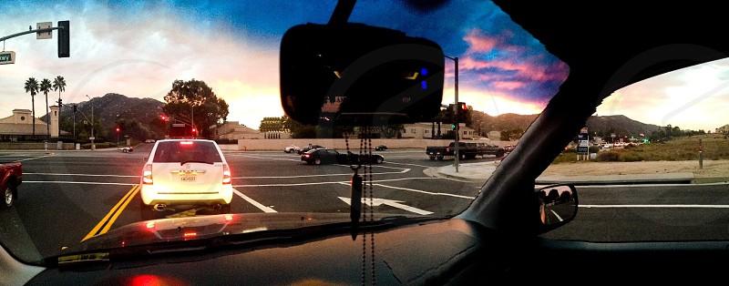 white vehicle traveling on road during daytime photo