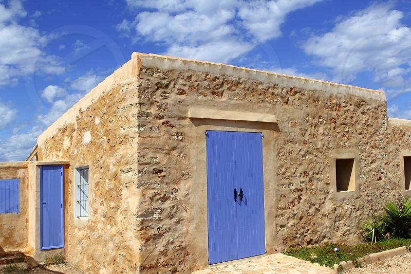 stone house masonry blue sky door windows Formentera Balearic photo