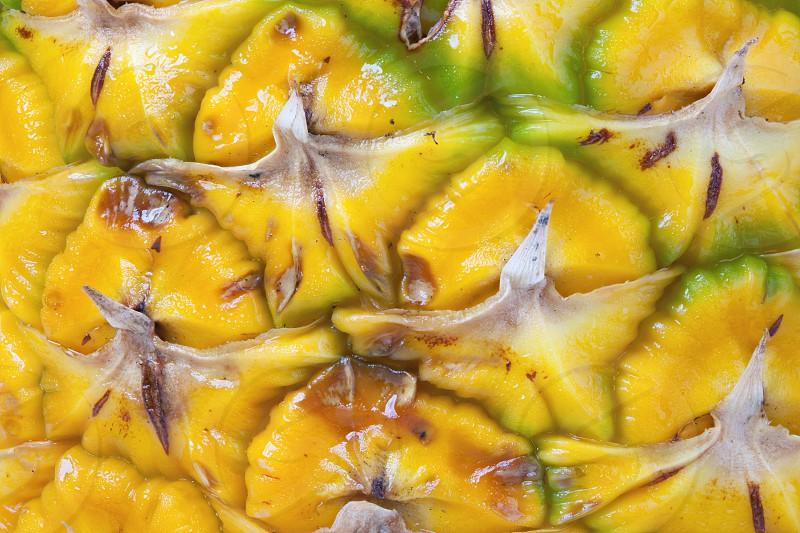 Macro texture of fresh pineapple. photo