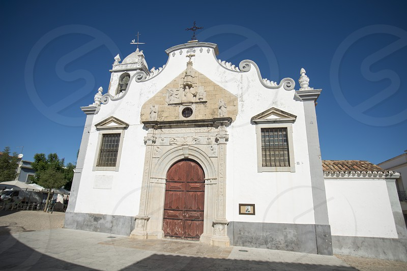 the old church in the old town of Moncarapacho near Olhao at the east Algarve in the south of Portugal in Europe. photo