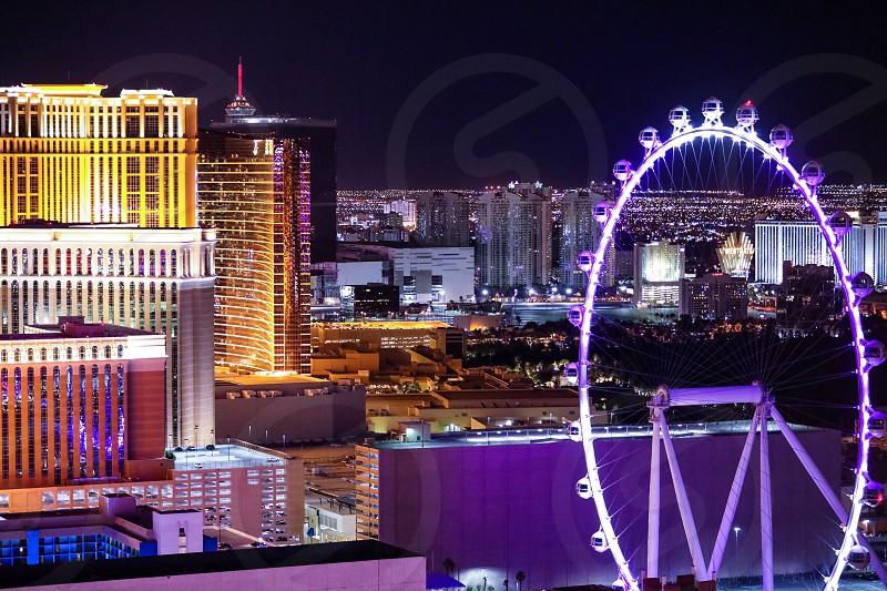 Las Vegasnightskylinecitylightsbuildingsscenicferris wheelpurplelandscape photo