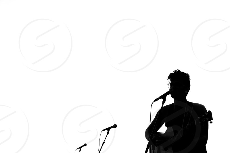 man playing guitar silhouette photo