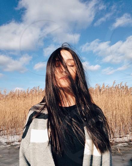 womanwith dark hair and grey jacket photo