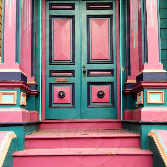 pink and teal wooden door photo