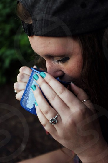 Young girl drinking coffee in the forest  photo