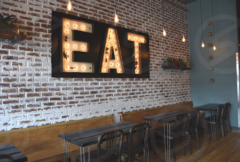 eat wall decor and black wooden table photo