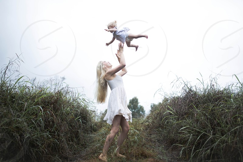 mother daughter playful emotions laughter beautiful landscape explore fun love good vibes lush greenery  photo