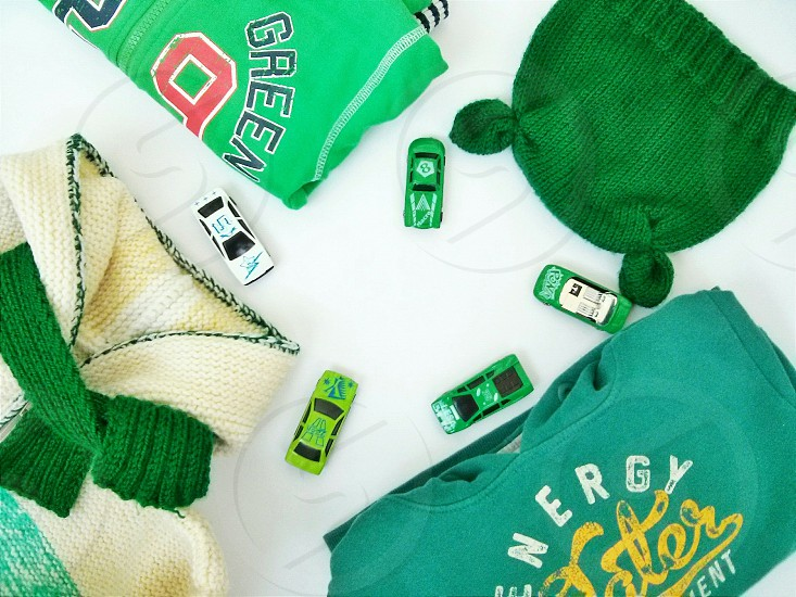 green baby clotheswhite background warm photo