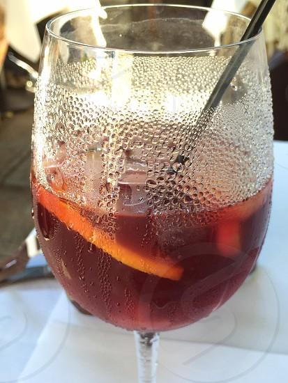 clear wine glass with black straw photo