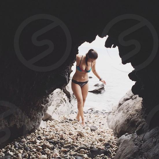 woman in black and teal bikini in a cave photo