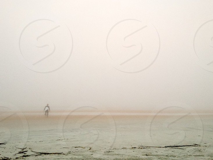 Fog surfer. Surf surfing foggy misty beach Florida. photo