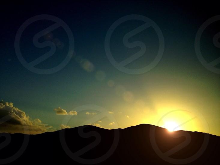 sunset on mountain silhouette photo