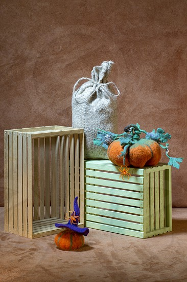 Still life with handmade pumpkins from felted wool for the celebration of Halloween photo