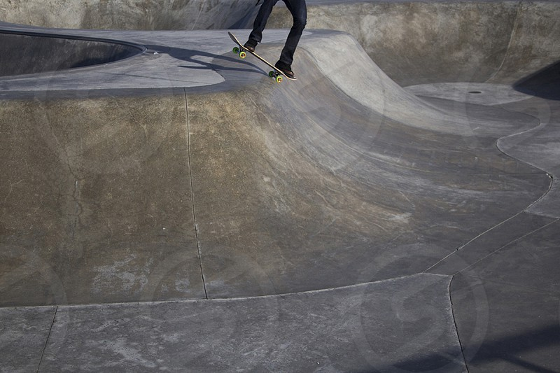 person skateboarding on a concrete slope photo