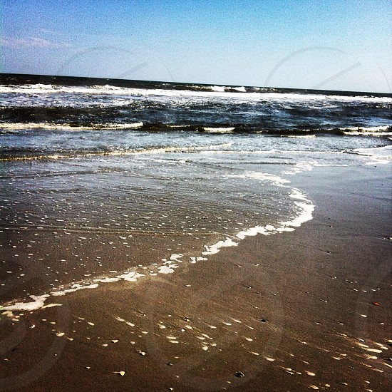 white and blue sea wave photo