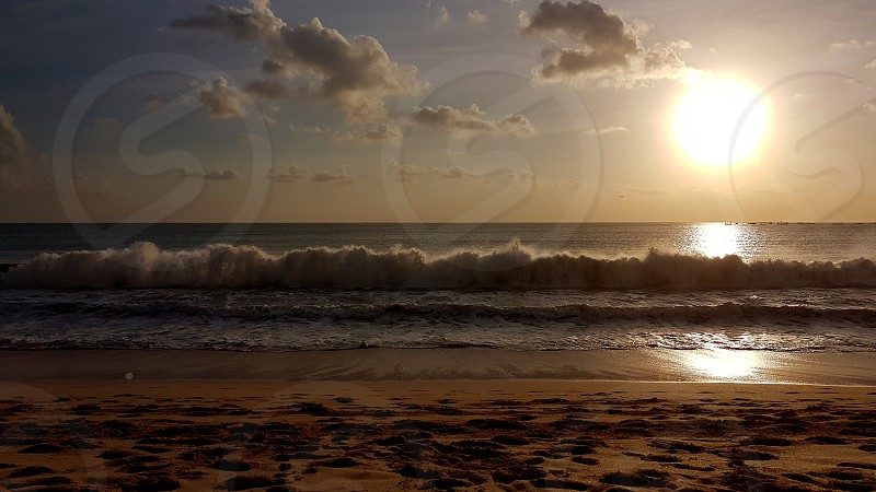 Sunset in Jimbaran Beach Bali Indonesia photo