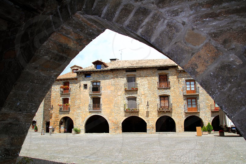 Ainsa medieval romanesque village streets in Huesca Aragon Pyrenees spain photo