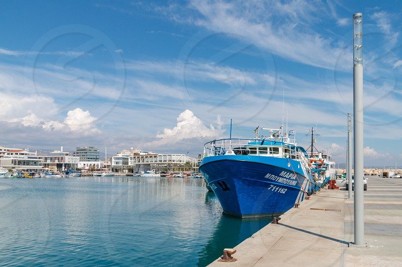 Blue ship on the pier in the port Cyprus Limassol photo