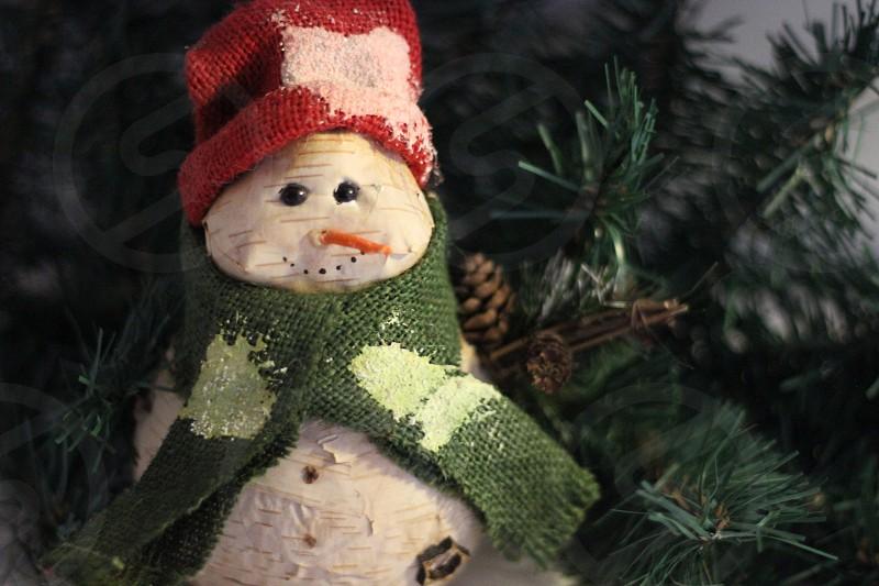 snow man decor on christmas tree photo