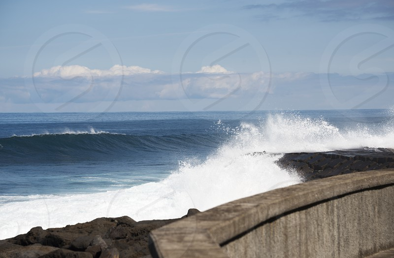 Waves breaking on the shore of Madeira island on Portugal coast mear Sao Vincence photo